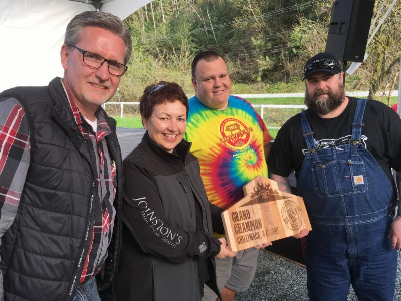 Sponsors Ken Falk (Fraser Valley Specialty Poultry/ The Farm Store) and Bonnie Windsor (Johnston's Pork) with grand championship winning pit master Rob Reinhardt and teammate Chris Dubord. PC: BBBQ